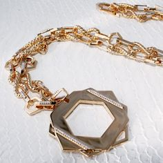 Trend: Oversize Pendants Never underestimate the power of a seriously stunning, oversize pendant necklace. The look-at-me style adds a retro-chic touch to any outfit—from leather leggings to an oversize tunic to a black-tie gown. Talk about a must-own. Gavriel Hexagon Pendant Necklace, Rachel Zoe $275