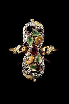Art Nouveau Flower Ring. Ruby, rose-cut diamond, formic roche, enamel, platinum & gold. France 1900-1910.