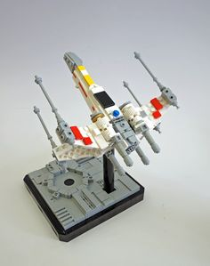 https://flic.kr/p/2117tLB | All clear | Let's blow this thing and go home!  An update to my midiscale X-wing (back third of body rebuilt) and a new stand :)