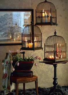 Candles in birdcages.