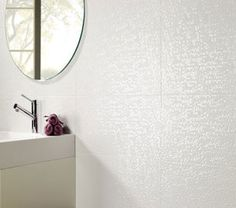 Capua Blanco is a stunning modern contemporary pearlescent mosaic effect wall tile. Capua will add style and individuality to any room. These tiles can be used alone, or used as a feature wall tile. Capua is reproduction of a the Porcelanosa tile range Cubica blanco but at a fraction of the price.