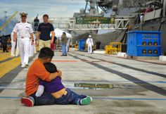 140307-N-WF272-002 PEARL HARBOR (March 07, 2014) Children of a Sailor assigned to the guided-missile destroyer USS O'Kane (DDG 77) comfort each other as the ship prepares for departure from Joint Base Pearl Harbor-Hickam for a deployment to the Western Pacific Ocean and Arabian Gulf. While deployed O'Kane will conduct Theatre Security Cooperation and maritime presence operations with partner nations. (U.S. Navy photo by Mass Communication Specialist 3rd Class Diana Quinlan/Released)