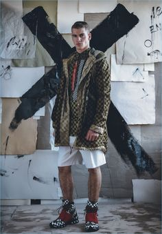 Model Matty Carrington sports a checkerboard print look from Givenchy.
