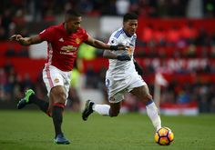 Antonio Valencia of Manchester United and Patrick van Aanholt of Sunderland compete for the ball during the Premier League match between Manchester United and Sunderland at Old Trafford on December 26, 2016 in Manchester, England.