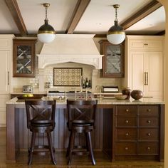 This traditional kitchen boasts with a combination of brown and cream cabinet design. Gold and brown granite, along with mosaic backsplash and glass front cabinets add a particular charm to the room. Check out more ideas:  😊 📷 Jean Stoffer Design ... traditional kitchen cabinet doors,traditional cabinets kitchen,modern traditional kitchen cabinets, traditional oak kitchen cabinets,black traditional kitchen cabinets, traditional black kitchen cabinets, traditional kitchen