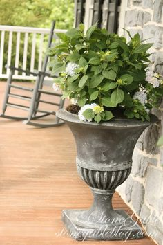 DIY:  How to Age a Flower Pot with Paint - this is an inexpensive way to give your old pots or urns an updated look - via Stone Gable Blog