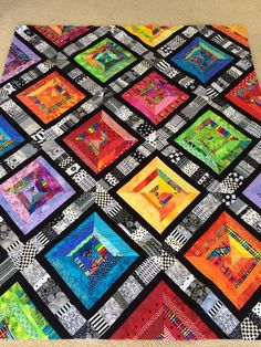 My Bright Scrappy Patchwork Quilt. Made with a strip of 3 inch black and white s. My Bright Scrappy Patchwork Quilt. Made with a strip of 3 inch black and white scraps on the diagon Colchas Quilting, Scrappy Quilts, Quilting Designs, Crazy Quilting, Quilting Ideas, Scrappy Quilt Patterns, Patchwork Blanket, Quilt Design, Paper Piecing