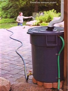 conserve water in downpipe tank > with hose attached for watering garden, cleaning car.