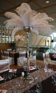 Feather Centrepiece- still elegant today! This would be beautiful with peacock feathers too!