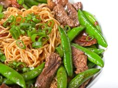 ramen : Stir-fried Beef and Snap Peas Toss a quarter pound of thinly sliced flank steak with half of the seasoning packet, then simmer the noodles just until they break apart (don't overcook them!). Drain the noodles and set them aside. In a large wok or skillet, heat a tablespoon of oil until smoking. Add the beef and cook without moving for about 1 minutes until well-browned. Toss the meat a few times. Add a quarter pound of snap peas and stir fry for about 1 minute. Add another tablespoon…
