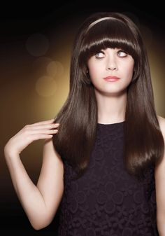 Click to find how Zooey Deschanel gets such beautiful hair!