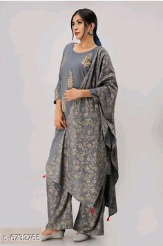 Dupatta Sets Women Rayon A-line Printed Long Kurti With Palazzos And Dupatta Kurta Fabric: Rayon Bottomwear Fabric: Rayon Fabric: Rayon Sleeve Length: Three-Quarter Sleeves Set Type: Kurta With Dupatta And Bottomwear Bottom Type: Palazzos Pattern: Printed Multipack: Single Sizes:  S (Bust Size: 36 in Kurta Length Size: Up To 42 in Bottom Waist Size: 28 inBottom Length Size: Up To 40 in Duppatta Length Size: 2 m)  XL (Bust Size: 42 in Kurta Length Size: Up To 42 in Bottom Waist Size: 34 in Bottom Length Size: Up To 40 in Duppatta Length Size: 2 m)  L (Bust Size: 40 in Kurta Length Size: Up To 42 in Bottom Waist Size: 32 in Bottom Length Size: Up To 40 in Duppatta Length Size: 2 m)  M (Bust Size: 38 in Kurta Length Size: Up To 42 in Bottom Waist Size: 30 in Bottom Length Size: Up To 40 in Duppatta Length Size: 2 m)  XXL (Bust Size: 44 in Kurta Length Size: Up To 42 in Bottom Waist Size: 36 in Bottom Length Size: Up To 40 in Duppatta Length Size: 2 m)  XXXL (Bust Size: 46 in Kurta Length Size: Up To 42 in Bottom Waist Size: 38 in Bottom Length Size: Up To 40 in Duppatta Length Size: 2 m) Country of Origin: India Sizes Available: S, M, L, XL, XXL, XXXL   Catalog Rating: ★3.9 (465)  Catalog Name: Women Rayon Printed Short Kurti With Palazzos And Dupatta CatalogID_1073381 C74-SC1853 Code: 275-6732765-2841