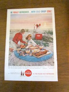 1959 original Coca-Cola be really refreshed...with cold crisp coke ad showing a beach picnic scene. Approx 7 x 10. Sevin dust ad on the reverse.
