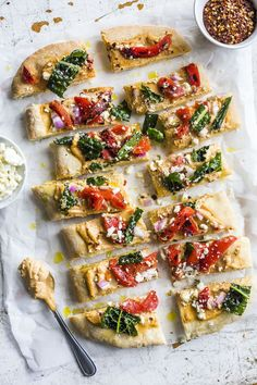Red Pepper Hummus Flatbread Pizza (pizza dough or flat out, roasted red pepper humus, fat free feta cheese) | the almond eater