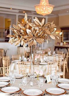 Oversized tree centerpieces on weddingwire reed petals florist 10 gold wedding touches for brides who want some gilded glam junglespirit Choice Image