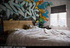 Graffiti on wall in teenage bedroom