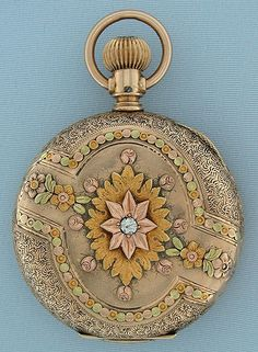 Lovely Illinois 6/S multicolor 14K gold antique ladies pendant watch circa 1887. The case engraved overall, with designs in four colors of gold, the cover with a diamond. White enamel dial (insignificant hairline) with blued steel hands. Nickel 15 jewel movement.