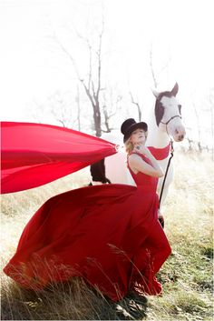 Bridal fashion shoot featuring a couture red wedding dress, a horse, red apples, and a bride in a top hat. Red Fashion, Fashion Shoot, Bridal Fashion, Red Wedding Dresses, Bridal Dresses, Red And White Weddings, Red Colour Palette, Bridal Cape, Shades Of Red