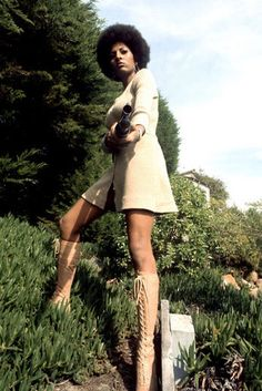 In another promotional photo for Coffy in 1973, Grier shows us who's boss in a mini dress and killer knee-high lace-up go-go boots.