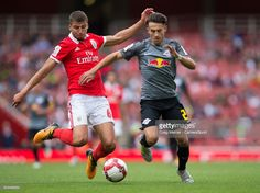 Benficas Ruben Dias vies for possession with RB Leipzig's Nicolas Kuhn during the Emirates Cup match between RB Leipzig and SL Benfica at Emirates Stadium on July 2017 in London, England. London England, Running, Sports, Amor, Fotografia, Pictures, Rb Leipzig, Hs Sports, Keep Running