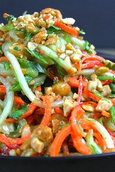 A fresh crunchy Asian Lime-Peanut Slaw with fresh cucumbers carrots and bell…