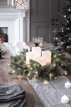 We've paired our green cable micro lights and blue spruce wreath together to create a sparkling festive decoration. With 50 warm white LEDs and miniature pinecone detail, you'll be transported to a winter woodland in no time at all! #christmastableideas