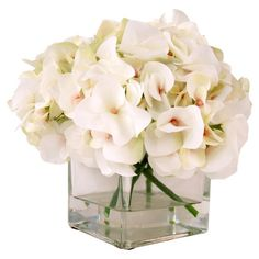 Create a lush tablescape or charming vignette with this lovely faux hydrangea arrangement, nestled in a classic glass cube vase.  Pr...