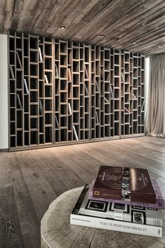 Perhaps this would keep books from getting lost on the shelf because of all the wood to break up the view, while still giving easy organization in one spot.