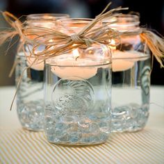 mason jars, put sand in the bottom fill with water, a flower, and a floating candle....