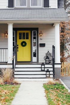Yellow door, dark gray trim, light gray siding