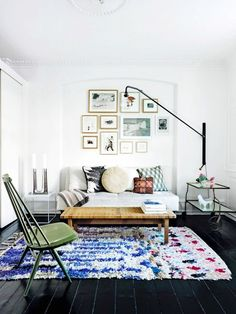 Eclectic living room with gallery wall and modern floor lamp