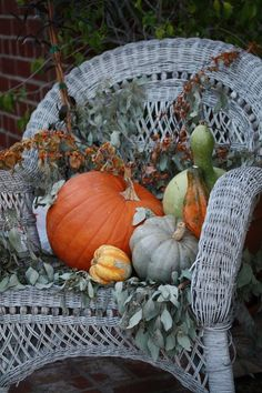 Fall display in an old wicker chair