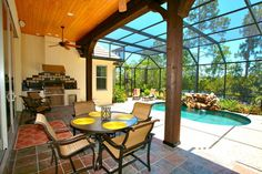 inspiring-mediterranean-patio-design-with-screen-enclosures-and-pool-small-pool-and-small-backyard-ideas-plus-summer-kitchen-under-stained-wood-beams-with-ceiling-fan-915x610.jpg (915×610)