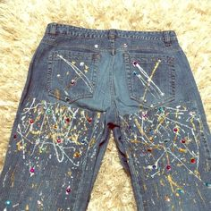 Boho Bling Jeans Very artsy jeans with silver and gold glitter paint throughout. Gem stones placed throughout in different colors. These jeans with a plain white shirt and some heels and you are smashing. Mid rise jeans the tag has size 6 tall however the inseam is 29. If you are the opposite of a plain Jane these jeans are for you. Metro 7 Jeans Boot Cut