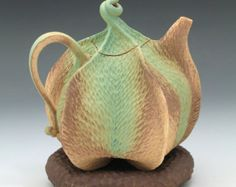 roberta polfus - Green & brown carved porcelain pod teapot with brown pillow