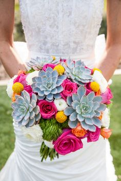 GORGEOUS wedding bouquet complete with bold hues of pink, orange, yellow, green and blue {George Street Photo & Video}
