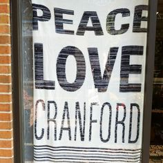 Peace, Love, Cranford hanging in the window at Anthem
