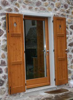 Porta ingresso in legno di larice con scuro decorato - Centurioni 1880