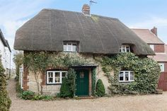 A charming two bedroom Grade II Listed thatched cottage on Rotten Row, Dorchester-on-Thames, OX10, with delightful gardens and a one bedroom annexe/studio with shower room. The property has a wealth of character features including an inglenook fireplace, wood burning stove and beams. There is a lovely cottage garden with attractive planting and several seating terraces.