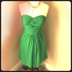 Jasmine B2 Strapless Dress Vibrant kelly green chiffon formal dress strapless dress with heavy ruching on the bodice front and back with a side ruching  and back zip. There is a part of the ruching that needs repair on the bodice but it is minor layered under it is not visible. This just is soooooo pretty and perfect for prom, bridesmaid , or rehearsal dinner attire . Jasmine  Dresses Midi