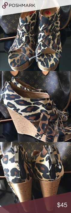 Xoxo Leopard  booties  wedge heels These super stylish leopardprint crisscross pattern open toe booties have a cork wedges heels and a cute zipper up the back. Brand-new with tags's. Perfect with any outfit from jeans to dresses. XOXO Shoes Wedges