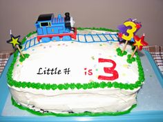 DIY Thomas Cake    Though I am not going to attempt to make a cake, this is what I think I will aim for.  Get a plane cake and draw some tracks (lines with frosting can't be *that* hard) and put a train on top.