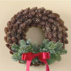 Pretty Pinecone Wreath - this wreath adds subtle holiday color to any room. Hot-glue pinecones to a wreath form, starting at the outside and working around the wreath toward the center. Wire evergreen sprigs to the bottom of the wreath, and hot-glue a simple red bow to the bottom center for a simple touch.