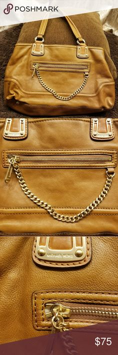 """💖Michael Kors💖 Leather Brown Shoulder Bag 💖Michael Kors💖 Leather Brown Shoulder Bag. It has several inside pockets. Also, a middle big pocket with a zipper. It has an ink stain at the bottom. 16.5"""" x 9"""" x 4"""". Dustbag not included. MICHAEL Michael Kors Bags Shoulder Bags"""