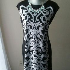 Print Dress Gorgeous printed dress!! Thicker material.  Has a great shape. Very fitted. Dresses Mini