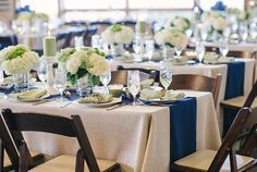 Table Decorations: Blue runner, green and white centerpieces