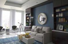 Bookcases flanking sofa-flex room