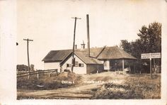 Real Photo Postcard Railroad Train Crossing & Creamery in Ellsworth, Iowa~112528