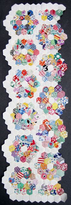 Grandmother's Flower Garden Doll Quilt, One of  my favorite quilts.