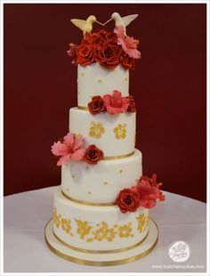 Red and Gold hibiscuse and hummingbird wedding cake
